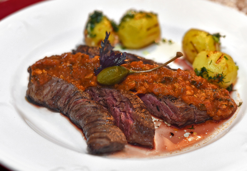 Siberian Cuisine - Chemodan - Grilled Yak Steak with Tomato, Mustard and Caper Sauce